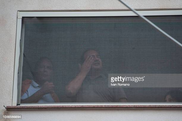CALABRIA ITALY OCTOBER The mayor Domenico Mimmo Lucano greets the demonstrators from his home on October 6 2018 in Reggio Calabria Italy Domenico...