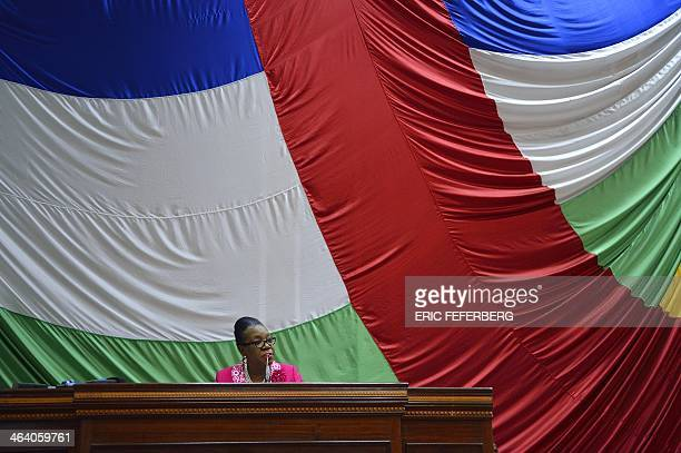 The mayor of Bangui Catherine SambaPanza speaks in front of thenational flag after being elected interim president of the Central African Republic on...