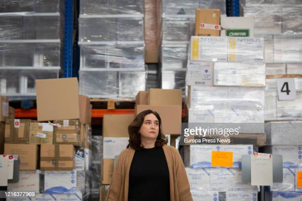 The mayor of Barcelona Ada Colau is seen with the 12 tons of sanitary material that the town has received from China the biggest ever ordered by the...