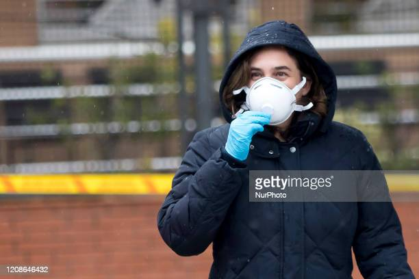 The Mayor of Barcelona, Ada Colau, wears a health mask during a visit to an action by the Barcelona Firefighters during the Coronavirus - Covid-19...