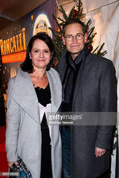 The mayor of Berlin Michael Mueller and his wife Claudia attend the 13th Roncalli Christmas at Tempodrom on December 17 2016 in Berlin Germany