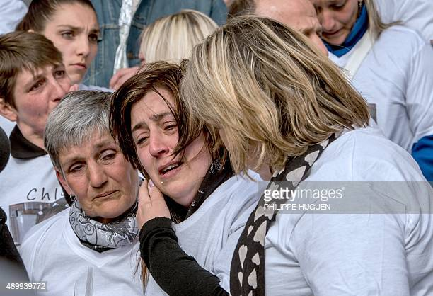 The Mayor of Calais Natacha Bouchart and the mother of Chloe a nineyearold girl who was killed a day before leave the city hall on April 16 2015 in...