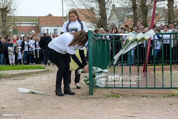 The Mayor of Calais Natacha Bouchart and the mother of Chloe a nineyearold girl who was killed a day before lay flowers on a playgrond as relatives...