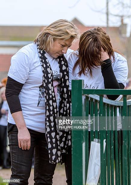 The Mayor of Calais Natacha Bouchart comforts the mother of Chloe a nineyearold girl who was killed a day before as relatives and people gather...