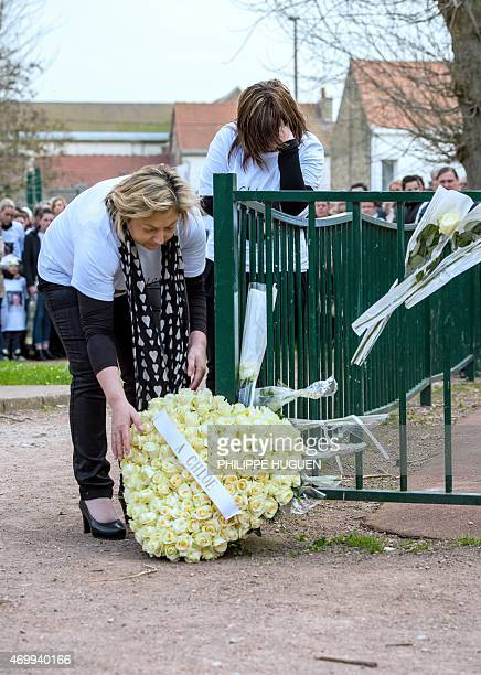 The Mayor of Calais Natacha Bouchart lays flowers next to the mother of Chloe a nineyearold girl who was killed a day before as relatives and people...