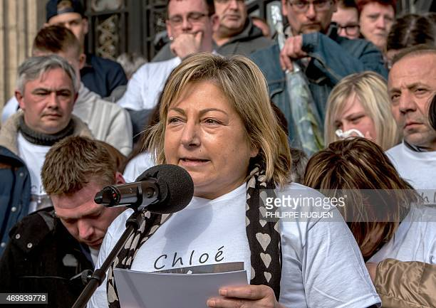 The Mayor of Calais Natacha Bouchart speaks next to the mother of Chloe a nineyearold girl who was killed a day before on April 16 2015 in Calais...