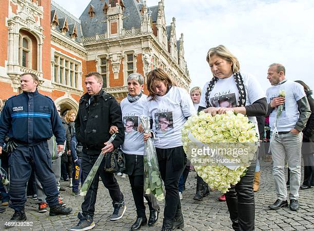 The Mayor of Calais Natacha Bouchart the mother of Chloe a nineyearold girl who was killed a day before and relatives take part in a march on April...