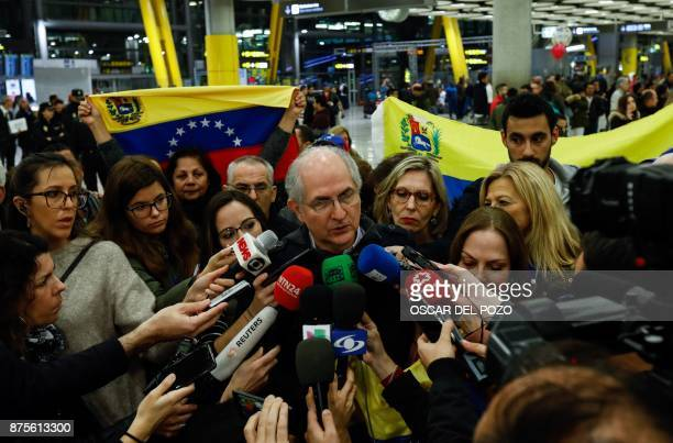 The mayor of Caracas Antonio Ledezma speaks to journalists upon his arrival to the Barajas Airport on November 18 2017 in Madrid Ledezma arrived from...