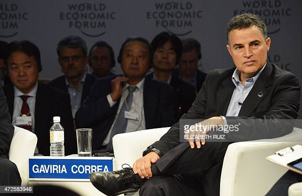 The Mayor of Colombian city Medellin Anibal Gaviria Correa takes parts in a meeting during the World Economic Forum on Latin America in Cancun...