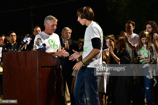The Mayor of Evesham Township NJ Randy Brown greets the brother of Christina Grimmie Mark Grimmie at the podium during the Vigil For Christina...