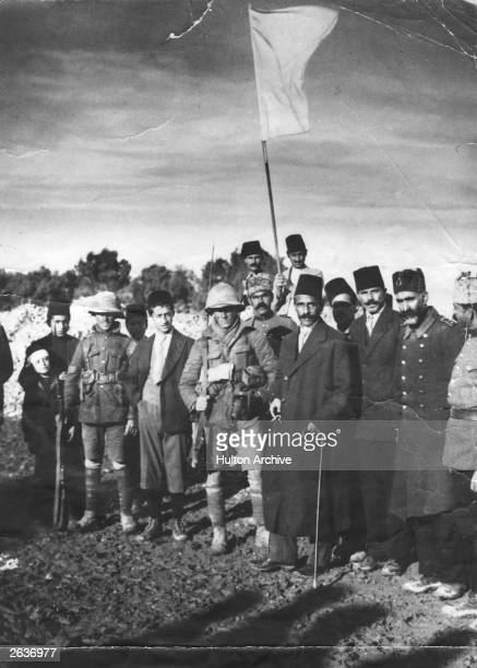 The Mayor of Jerusalem Hussein Husseini 3rd from right surrenders the Holy City to Sergeant F H Hurcomb 5th from right Also present Sergeant James...