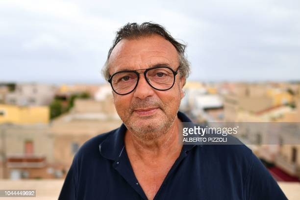 The mayor of Lampedusa Salvatore Martello poses on the city hall terrace in Lampedusa on September 26 2018 Five years after the worst shipwreck of...