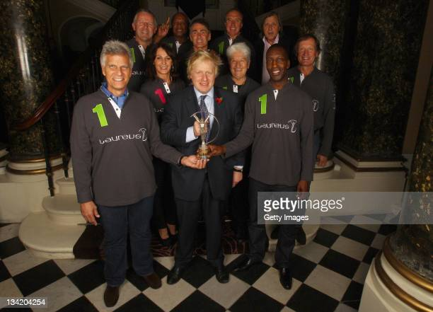 The Mayor of London Boris Johnson holds a Laureus Sports Award Trophy with Laureus Academy Members Mark Spitz Sean Fitzpatrick Nadia Comaneci...