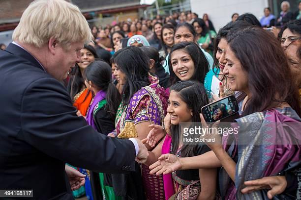 The Mayor of London Boris Johnson meets members of the Hindu community at Shree Swaminarayan Mandir a major new Hindu temple being built in Kingsbury...