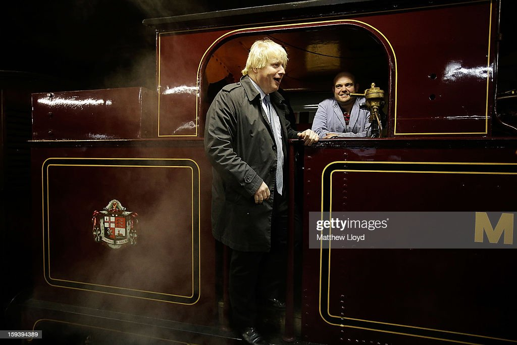 The Mayor Of London Boris Johnson poses for the media in the cab of a restored 1898 steam engine, known as Met Locomotive No. 1, after it arrives at Moorgate station in a recreation of the first London Underground journey on January 13, 2013 in London, England. The London Underground celebrates its 150th birthday this month, the Metropolitan line being the first stretch between Paddington and Farringdon stations.