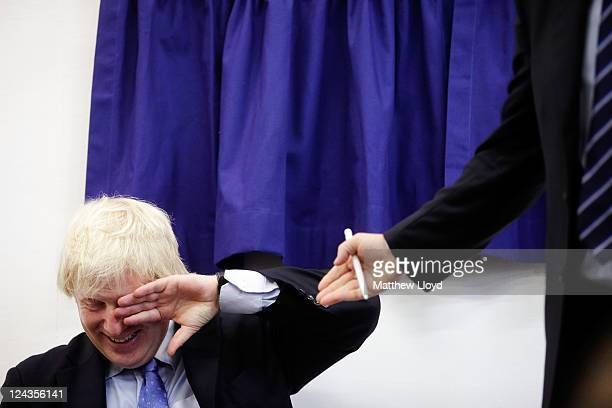 The Mayor of London Boris Johnson reacts to a joke from author Toby Young in front of gathered parents pupils and teaching staff at the opening of...