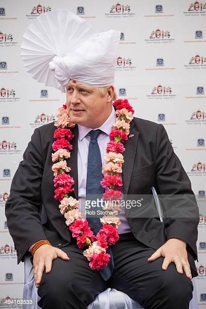 The Mayor of London Boris Johnson wears a traditional headdress during a visit to the Shree Swaminarayan Mandir a major new Hindu temple being built...