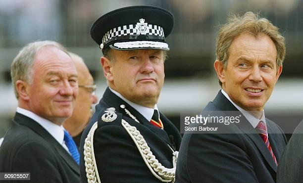 The Mayor of London Ken Livingstone Sir John Stevens Commissioner of the Metropolitan Police Service and British Prime Minister Tony Blair look on...