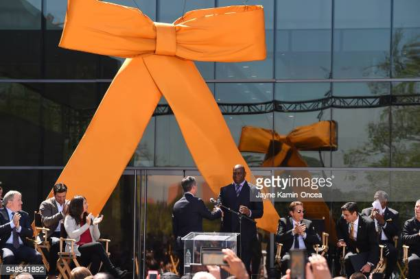 The Mayor of Los Angeles Eric Garcetti shakes hands with owner Magic Johnson as he speak to fans and media during the ribbon cutting ceremony for the...