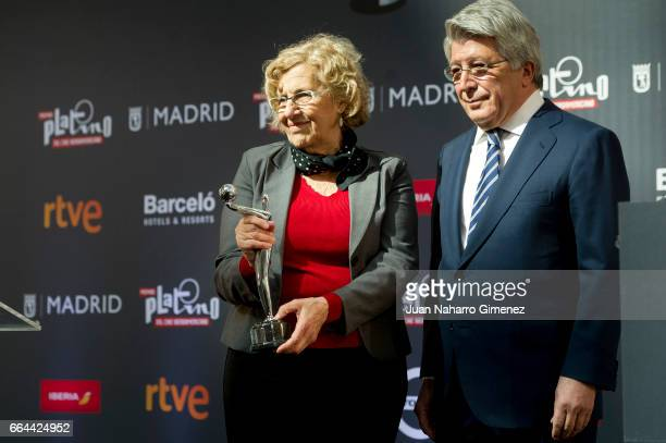The Mayor of Madrid Manuela Carmena receives the Platino award to Madrid from producer Enrique Cerezo during the 'Platino Awards 2017' presentation...