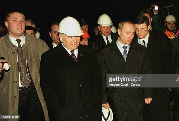 The Mayor of Moscow Yuri Luzhkov and Vladimir Putin arrive at the underground building site