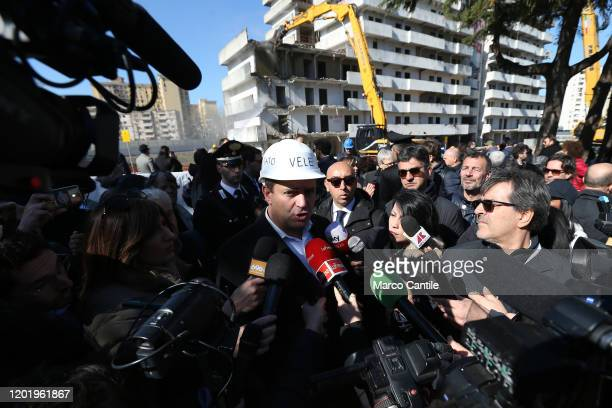 The mayor of Naples Luigi de Magistris speaks with journalists during the demolition of the building known as Vela Verde in the Scampia district of...