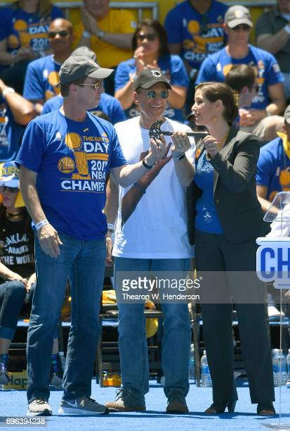 The Mayor of Oakland Libby Schaaf present the key to the city to Golden State Warriors owners Joseph Lacob and Peter Guber in front of the Henry J...