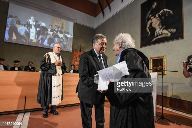 The mayor of Palermo, Leoluca Orlando and Israeli writer Abraham B. Yehoshua shake hands after the magnificent rector Fabrizio Micari of the...