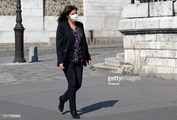 The mayor of Paris Anne Hidalgo arrives to a blessing ceremony by Archbishop of Paris Michel Aupetit in front of the SacreCoeur Basilica on the Holy...