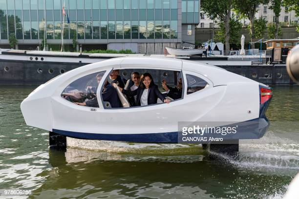 The mayor of Paris Anne Hidalgo is photographed for Paris Match on the Seine, aboard a SeaBubbles a electric flying taxi on May 25, 2018 in Paris,...