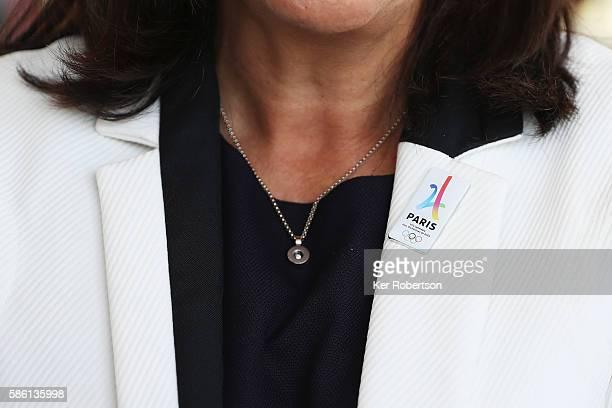 The Mayor of Paris Anne Hidalgo wears a Paris 2024 pin badge while talking at a press conference given by the Paris 2024 Candidate Olympic City...