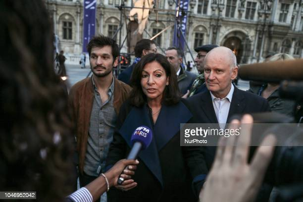 The Mayor of Paris Anne Hidalgo with sculptor Ugo Schiavi speaks with press as she launches the Nuit Blanche 2018 in front of City Hall on october 6...