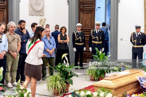 The mayor of Rome Virginia Raggi in front the coffin of Italian actor Paolo Villaggio lying in repose at Rome's city hall on July 5 2017 in Rome...