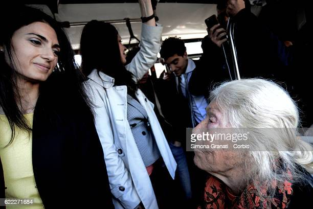 The mayor of Rome Virginia Raggi speaks with an elderly woman on the bus during the presentation of the first 25 new buses for the supply of 150...
