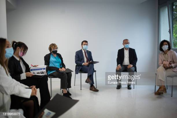 The mayor of Sabadell Marta Farres ; and the president of the Generalitat Pere Aragonès , during a meeting with the director of the Service Diego...