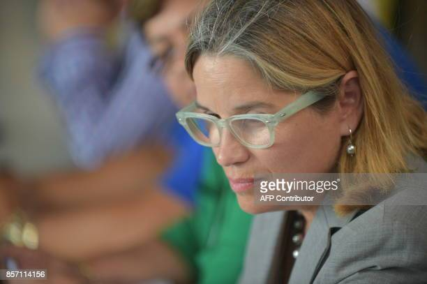 The mayor of San Juan Carmen Yulin Cruz attends a meeting with US President Donald Trump and First Lady Melania Trump upon their arrival at Luis...