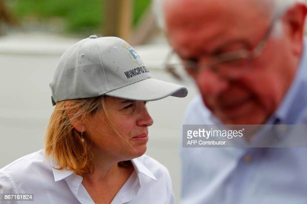 The mayor of San Juan Carmen Yulin Cruz pauses while talking to US Sen Bernie Sanders during a visit to the Playita community in San Juan Puerto Rico...