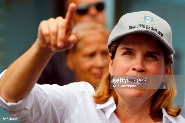 The Mayor of San Juan Carmen Yulin Cruz points as she visits the Playita community with US Sen Bernie Sanders in San Juan Puerto Rico on October 27...