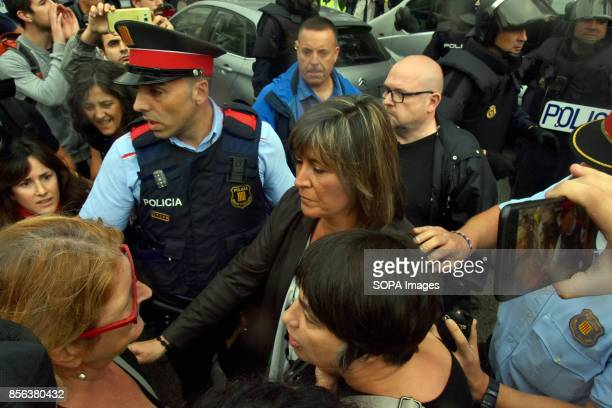 The Mayor of the city of L´Hospitalet Nuria Marín make an approaches to talk to the police commander National Police entered by force in the High...