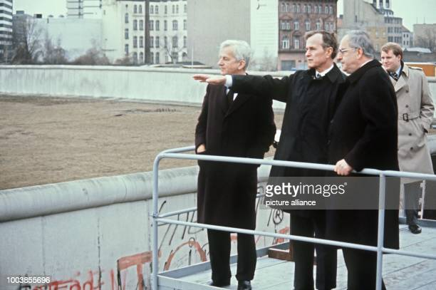 The mayor of West Berlin, Richard von Weizsaecker, American vice president George Bush and the West German chancellor Helmut Kohl on a viewing...