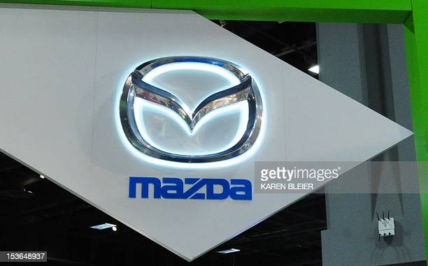 The Mazda logo is seen February 2 2012 at the 2012 Washington Auto Show at the Walter E Washington Convention Center in Washington DC The auto show...