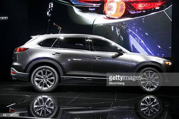The Mazda Motor Corp 2016 CX9 midsize sports utility vehicle is unveiled during the Los Angeles Auto Show in Los Angeles California US on Wednesday...