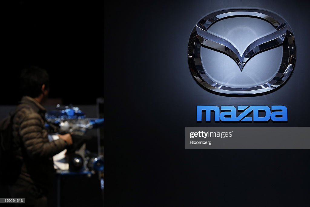 The Mazda Motor Corp. logo is displayed at the Tokyo Auto Salon 2013 at Makuhari Messe in Chiba, Japan, on Friday, Jan. 11, 2013. The Tokyo Auto Salon runs until Jan. 13. Photographer: Kiyoshi Ota/Bloomberg via Getty Images