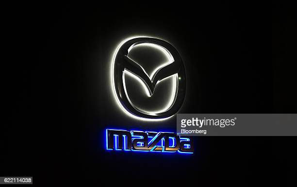 The Mazda Motor Corp logo is illuminated at the launch of the company's Roadster RF vehicle in Tokyo Japan on Thursday Nov 10 2016 Mazda unveiled the...