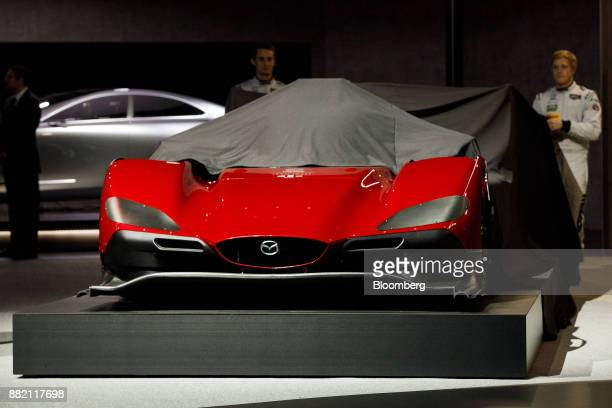 The Mazda Motor Corp Mazda RT24P racing vehicle is unveiled during AutoMobility LA ahead of the Los Angeles Auto Show in Los Angeles California US on...
