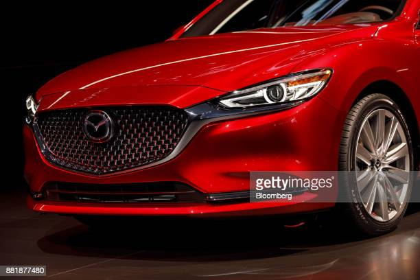 The Mazda Motor Corp Mazda6 vehicle is unveiled during AutoMobility LA ahead of the Los Angeles Auto Show in Los Angeles California US on Wednesday...