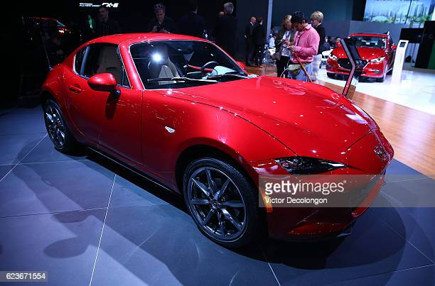 The Mazda MX5 is seen on the Mazda showroom floor at the LA Auto Show on November 16 2016 in Los Angeles California
