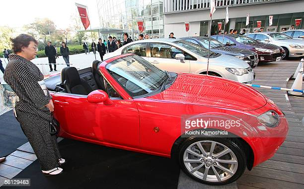 The Mazda Roadster sports car also known as the MX5 stands on display during the Car of the Year Japan awards November 9 2005 in Tokyo Japan The...