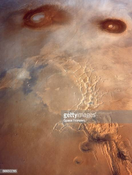 The maze of canyons on the surface of Mars known as the Noctis Labyrinthus situated below the shield volcanoes Arsia Mons and Pavonis Mons circa 1980...