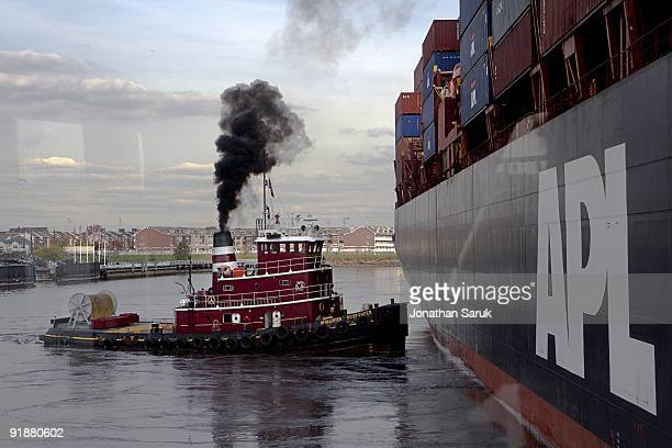 The McAllister Responder aided by other tugboats assists a container ship as it comes to port November 8 2007 in New York City McAllister Towing has...
